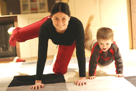Mother and son doing pilates