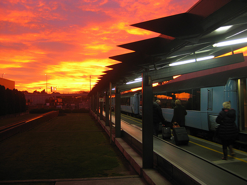 boarding a train at sunrise